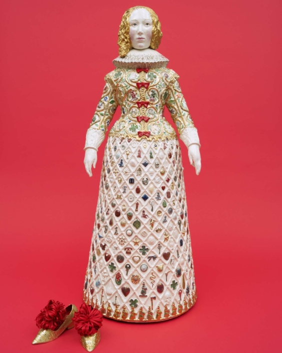 "Claire Partington, Lady Luck, 2021, Ceramic and mixed media + brass shoes, 32"" x 12.5"" x 12.5"""