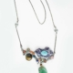 Sunset with Silver Cloud Necklace, 2021, Silver, found vintage carved Jade, turquoise, pink opal, Ethiopian opal, pink and red coral, lace agate, cats eye, and lapis lazuli. Approximately 3.5w x 3t x .5d inches