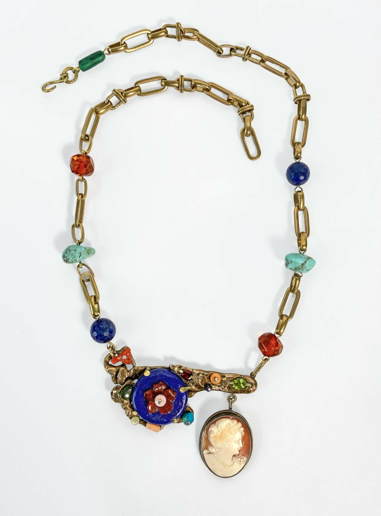 Orange and Blue Necklace with Cameo, 2021, Bronze, brass, silver, found antique carved shell cameo, lapis lazuli, carnelian, peridot, turquoise, garnet, coral, sapphire, Ethiopian opal, chrome diopside and baltic amber. Total length with chain- 27in Center section - 3.25 w x 2.5 t inches